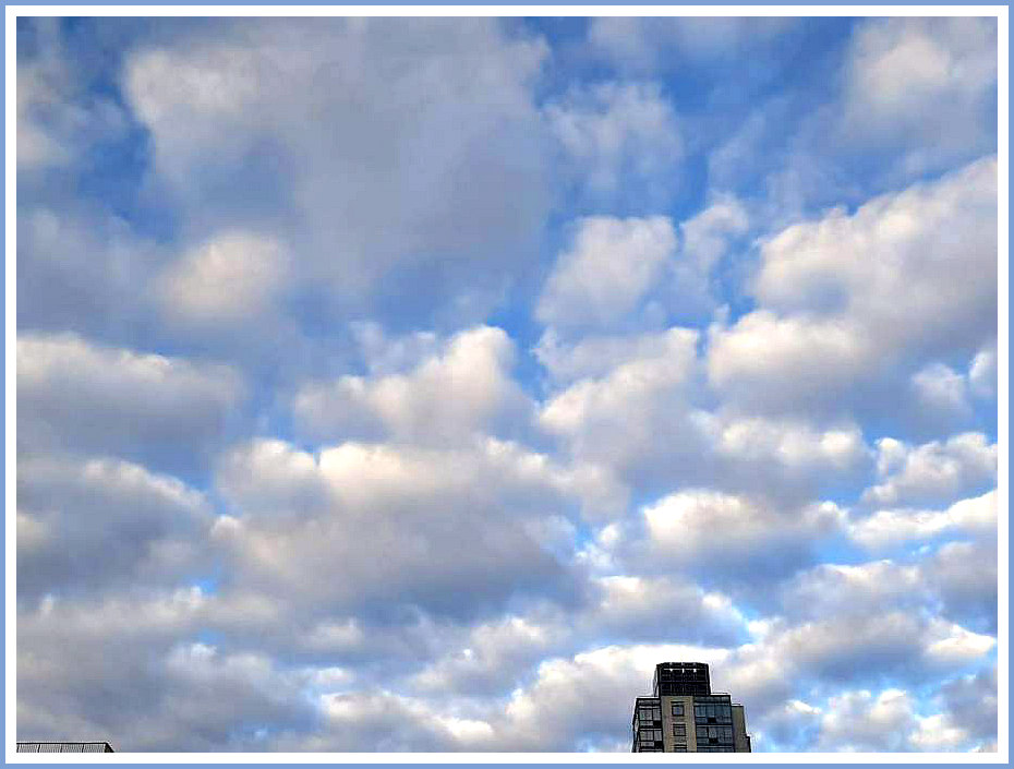 naama-clouds-and-building.